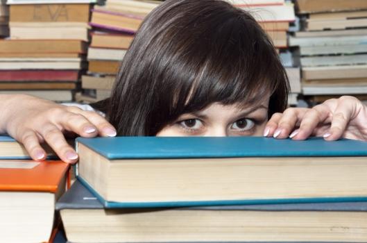 hiding behind books
